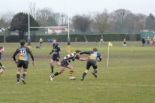 Scrum half Davis tries to shake off the OH defender