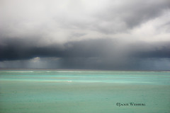 Rain clouds over the Atlantic Ocean in Turks and Caicos Islands photo by jackie weisberg