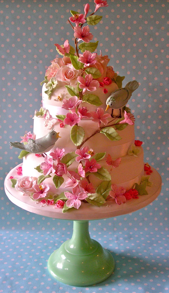 Pastel bird and blossom wedding cake photo by nice icing