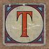 Vintage brick letter T