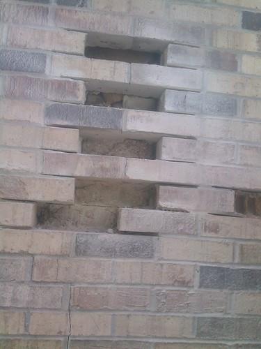 Brick repair on home