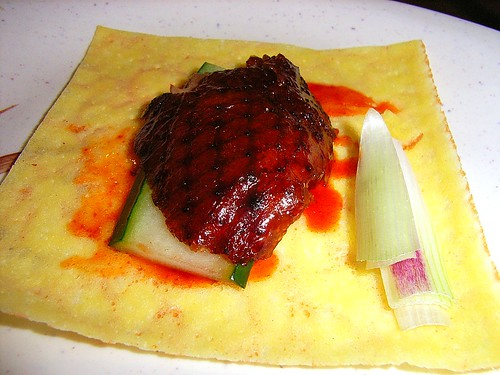 Roast Peking Duck with Cucumber, Spring Onions and Sweet Sauce on Egg Roll Skin