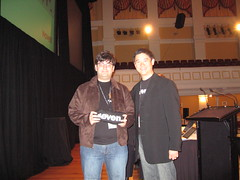 Tony Chor giving Ben Goodger (lead developer of Firefox) an IE7 t-shirt.