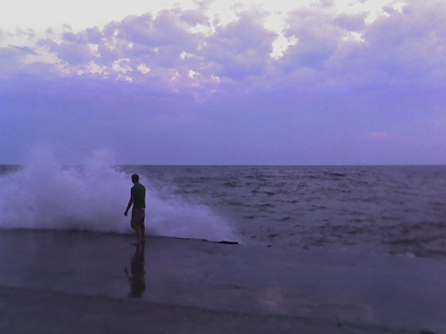 dude at the end of the grand haven pier, heavy seas 2