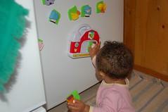 Julia discpvers the fridge toys