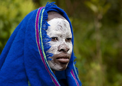Surma woman with painted face in Kibbish - Ethiopia photo by Eric Lafforgue