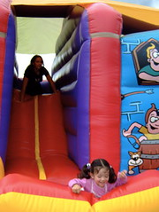 Daughter on a bouncy-caslte,