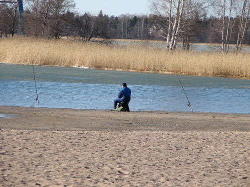 Fisherman at Hietaniemi beach