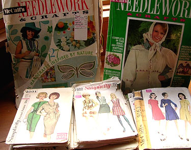 a stack of vintage sewing patterns