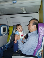 Playing with Ah Gong on the plane