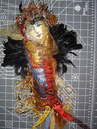 front of winged doll