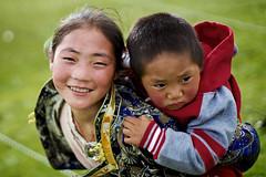 Beautiful Tibetan girl and tibetan baby at traditional dancing party, Litang, Kham, Tibet photo by Alex_Saurel