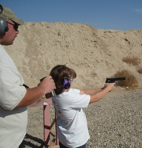 Ashley shooting pistol at Ruger Rimfire