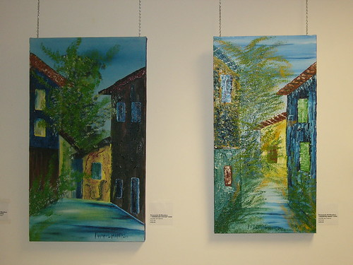Two paintings of Mr. Di Martino's home town in, Minas Gerais, Brazil