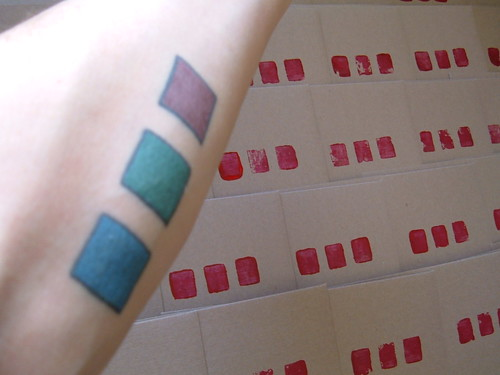 Red, green, and blue squares inside left forearm