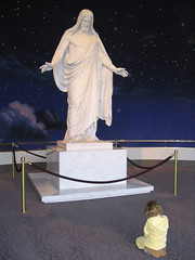 Girl praying at the Christus