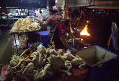 Selling chickens at Talad Khlong Toey, Bangkok, Thailand photo by www.igorbilicphotography.com