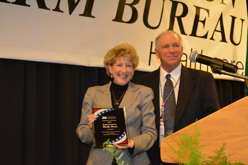 Rep. Shelly Short receives the Washington Farm Bureau's 2013 Legislator of the Year award from WFB President Mike LaPlant