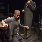 LaShawn Banks (Actor/Dying Man) and Marc Grapey (Robert Hooke) in ISAAC'S EYE at Writers Theatre.  Photo by Michael Brosilow.