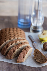 sliced rye bread with a knife, walnuts, pear, pepper,vertically photo by harmonyandtaste
