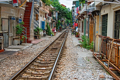 Railway line in Hanoi that runs through the city so close to shops and homes photo by CamelKW