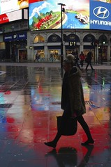 Commuter silhouetted against the lights at piccadilly circus 8 am in the morning Feb 14th 2013 photo by Daniel.15
