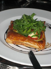 Baked Puff Pastry Tart w/ leeks a la grecque, slow roasted tomatoes & crottin goats cheese  £5.50