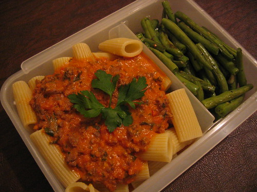 [bento with penne and pasta sauce, roasted green beans]