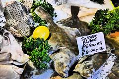 Fresh fish stall photo by simonturkas