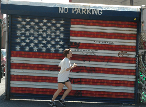 Jogging Past Flag Garage