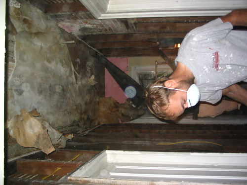 Demolishing the hallway ceiling.