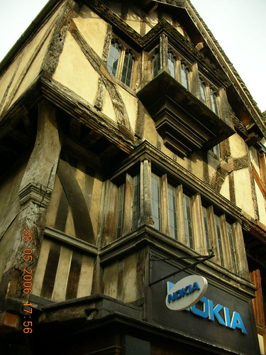 Old tudor over commercialized giant