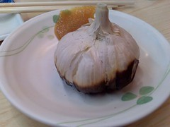 Garlic roasted on a flame