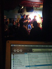 The Stand's tiny stage, viewed over the tiny screen of a tiny laptop from the tiny tech-cupboard
