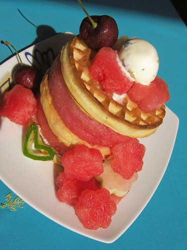Flowers made with Watermelon,Watermelon rounds clubbed with Waffles andtopped with cherries,Vanilla - pistachio Ice cream,HEART made with watermelon  rind