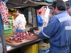 Vendor prepares fish