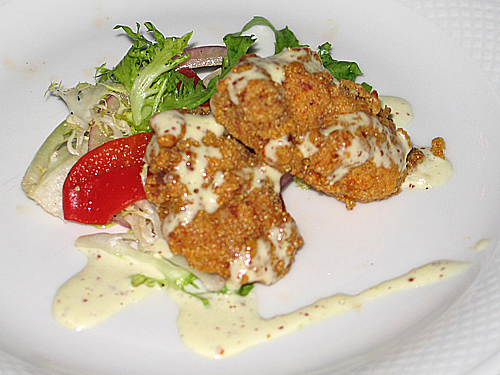 Amuse bouche: Andouille-Crusted Oysters with Green Salad and White Rémoulade Sauce