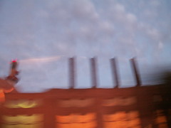 second view of a factory at dusk