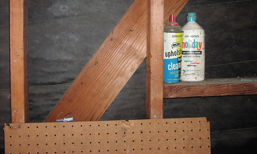 Remove a board, find some old car care items!