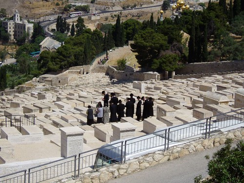 Jews perorming ritual a burial ground in Mount of Olives