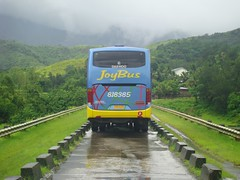 JoyBus passing through Canili-Diayao Dams photo by Normand Seven