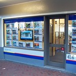 Barfoot & Thomson Real Estate window display