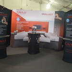 Cavius Exhibition kit with Waveline display wall and Icon Fabric bannerstands at the front of the stand