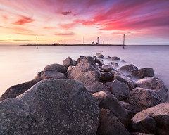 Sunset lighthouse photo by Oscar Bjarna