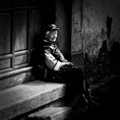 Old chinese woman resting on the stoop photo by IanBrewer