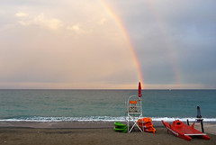 Rainbows over Pietra Ligure beach... photo by frozencycler