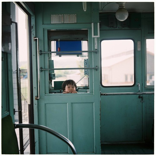 Girl in train in summer in inland sea photo by *dapple dapple
