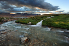 Listen to water flowing into the lake photo by Sayid Budhi