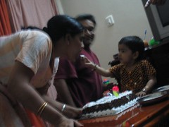 Giving Amma a bite of the cake