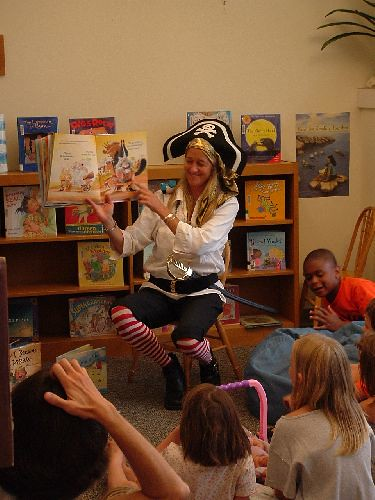 Amy the pirate reading tales of the high seas